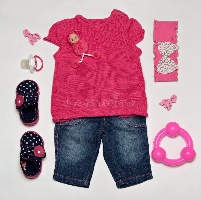 De kleren van het babymeisje royalty-vrije stock afbeeldingen