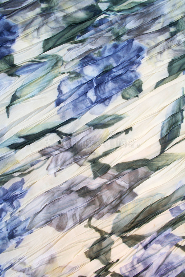 De kleurenpatroon van het water van blauwe bloemen op een stof royalty-vrije stock foto