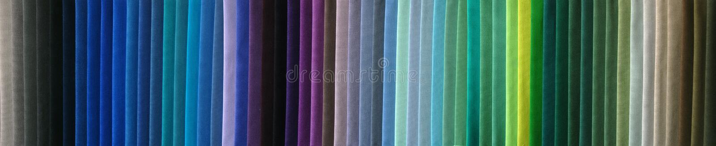 De kleurensteekproeven van de stof stock afbeeldingen