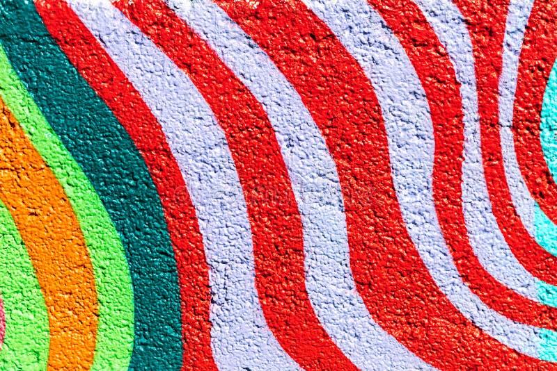 De kleurrijke achtergrond van de straatkunst fragment van graffiti stock fotografie