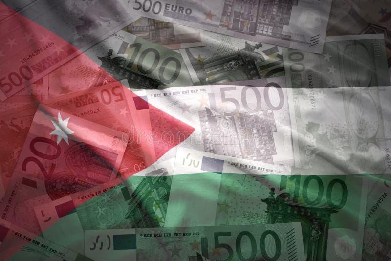 De kleurrijke golvende vlag van Jordanië op een euro achtergrond royalty-vrije stock afbeelding