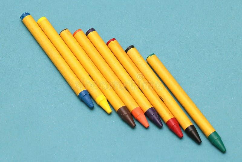 De kleurrijke Kleurpotloden van de Was stock foto's
