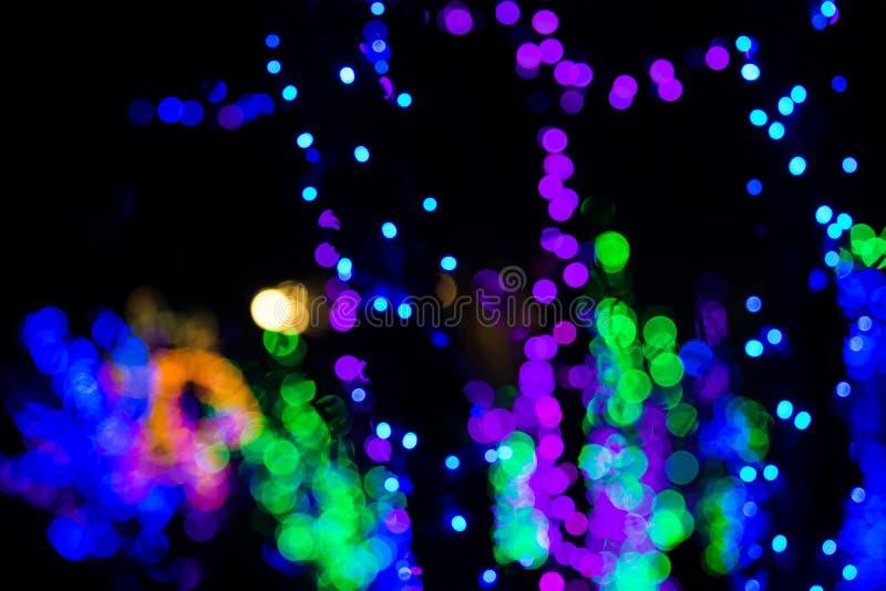 De kleurrijke Lichten van Kerstmisbokeh stock fotografie