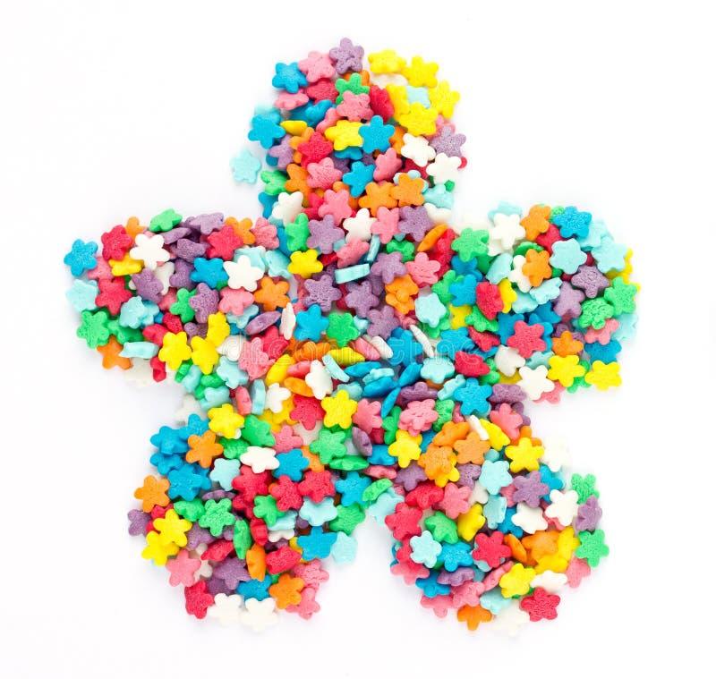De kleurrijke suiker bestrooit gevormde bloem royalty-vrije stock foto