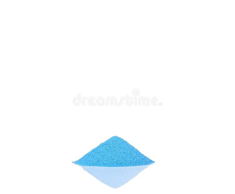 De kleurrijke zandstapel op wit isoleert royalty-vrije stock afbeelding