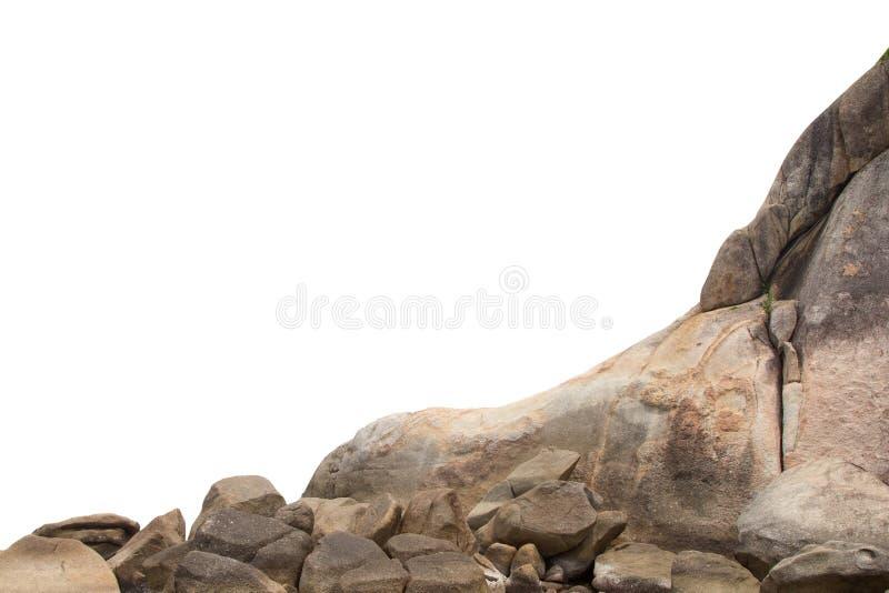 De klippenstenen isoleerden witte achtergrond stock foto