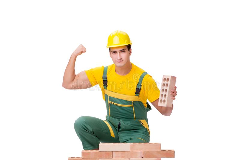 De knappe de bouwvakkerbouw bakstenen muur stock foto's