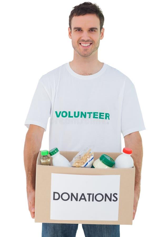 De knappe doos van de mensen dragende schenking met voedsel royalty-vrije stock foto's