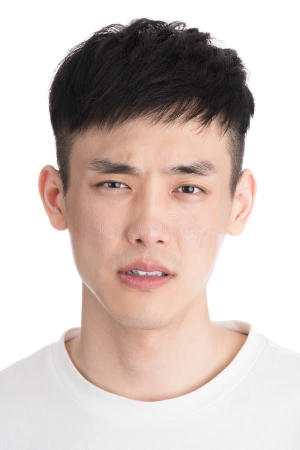 De knappe jonge die mens van Azië - over een witte achtergrond wordt geïsoleerd stock foto's