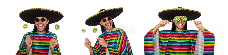 De knappe man in levendige die ponchoholding lollypop op wit wordt geïsoleerd stock foto