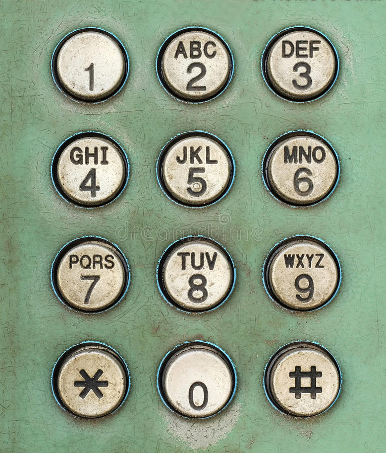 De knoop van het wijzerplaataantal op oude gebruikte openbare telefoon royalty-vrije stock afbeeldingen