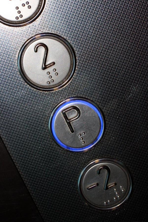 De knopen van de lift stock foto