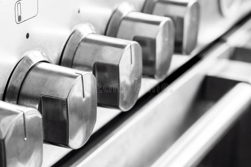 De knoppen van het roestvrij staalkooktoestel stock fotografie
