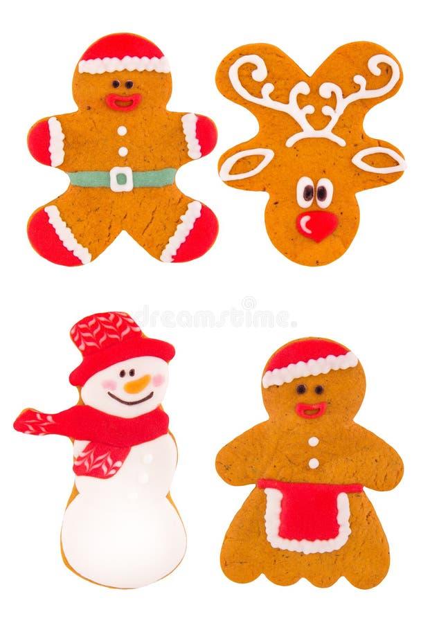 De koekjes van de Kerstmispeperkoek in de vorm van een hert, de weinig mens en een senovica Traditionele eigengemaakte snoepjes v stock afbeelding
