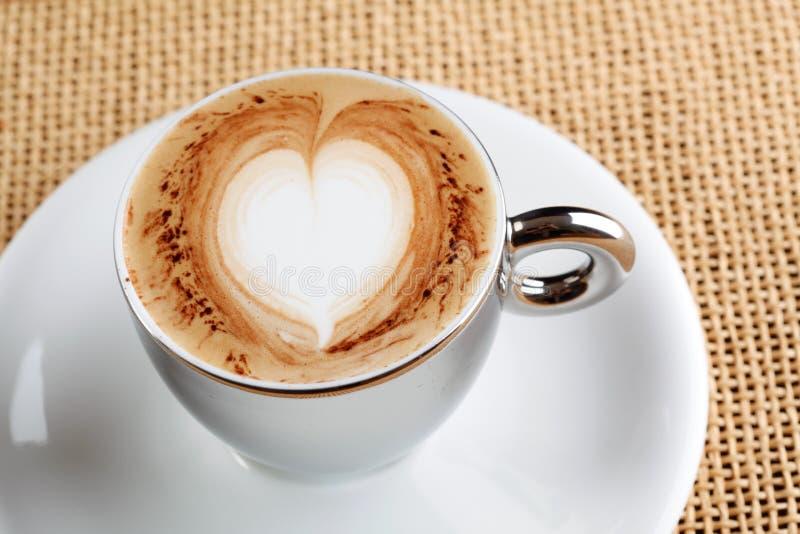 De koffiekop van cappuccino's stock afbeelding