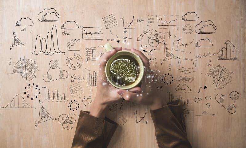 De koffiekop van de handholding en bedrijfsstrategie en idee royalty-vrije stock foto