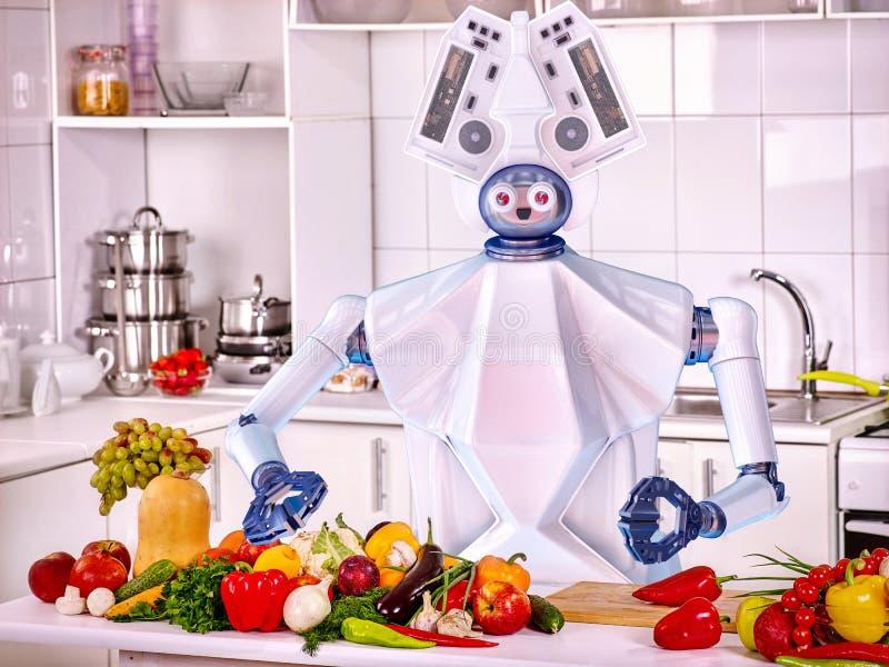 De kok vegetarisch voedsel van de robot binnenlands hulp bij keuken stock afbeeldingen