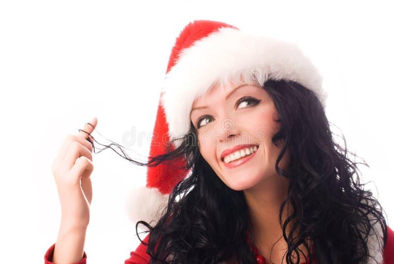 De kokette donkerbruine vrouw kleedde zich als Kerstman stock afbeeldingen