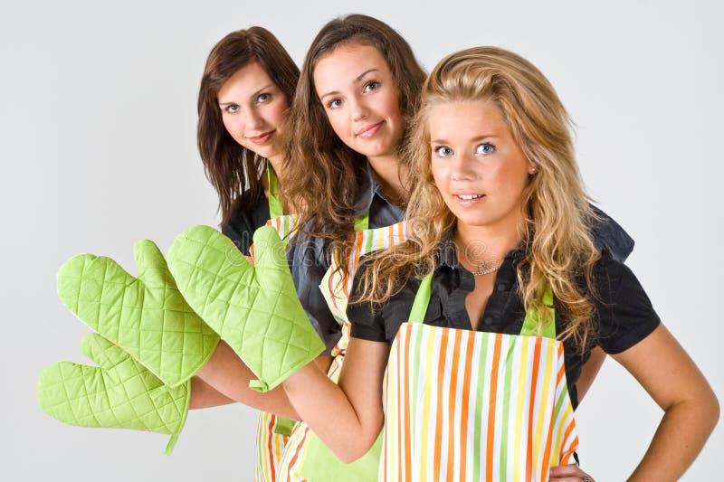 De koks van het meisje het begroeten stock foto's