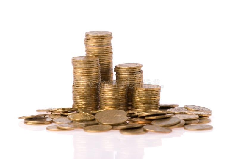 De kolom van vele geldmuntstukken stock afbeelding