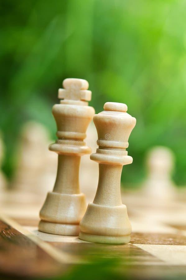 De koning en de koningin van het schaak stock afbeelding