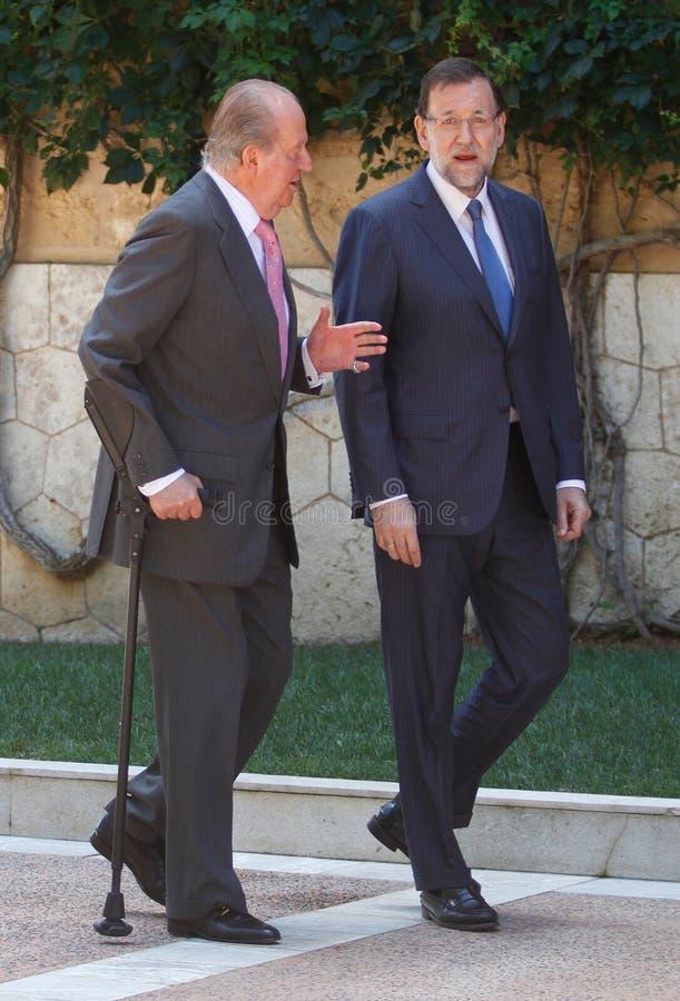 De Koning (juist) Juan Carlos van Spanje en Eerste minister Mariano Rajoy stock fotografie