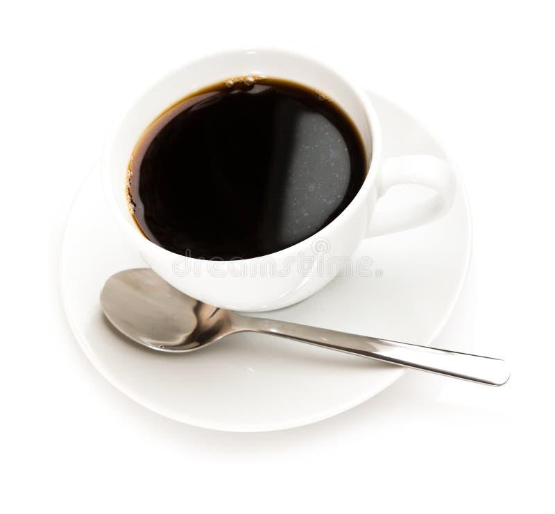 De kop en de lepel van de koffie stock afbeeldingen