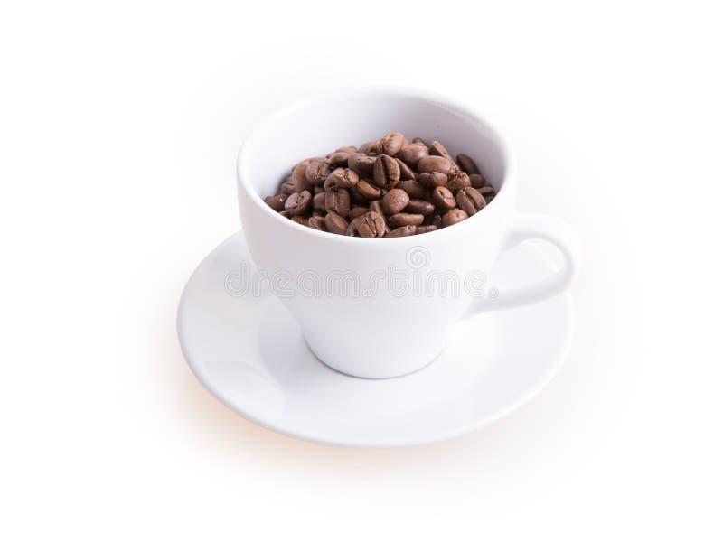 De kop van de koffie en koffiebonen royalty-vrije stock afbeeldingen