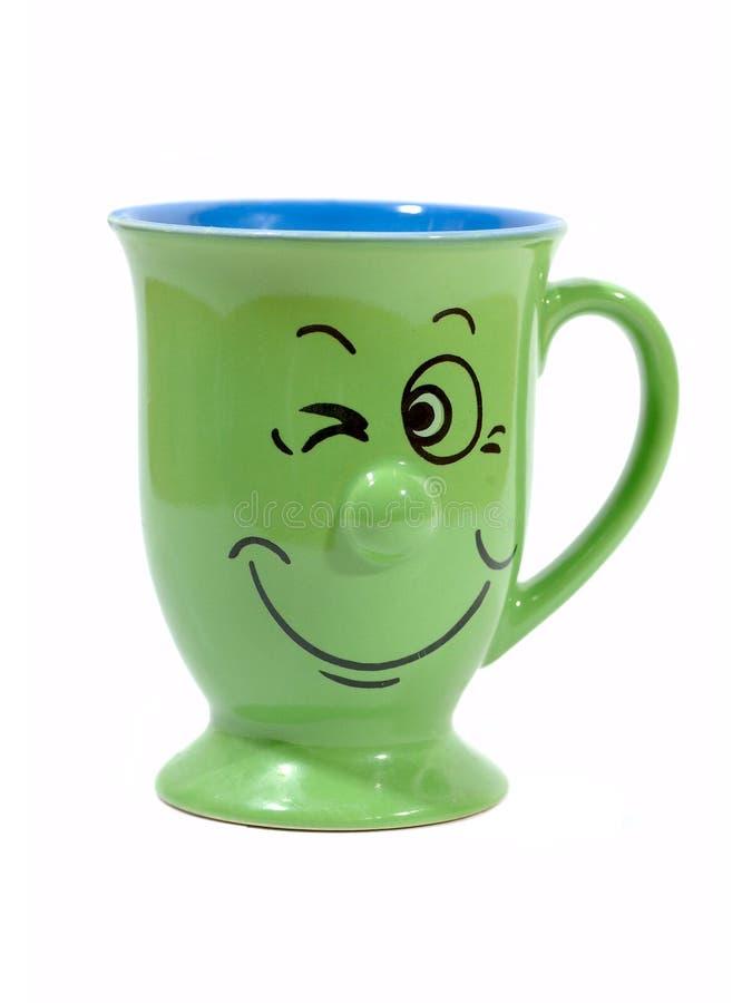 De kop van de koffie met een grijns stock afbeelding