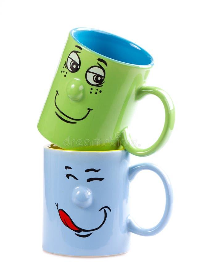 De kop van de koffie met een grijns stock fotografie