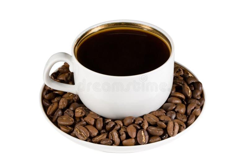 De kop van de koffie met koffiebonen stock afbeelding