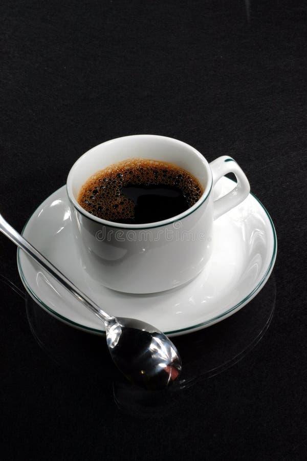 De kop van de koffie met lepel royalty-vrije stock fotografie