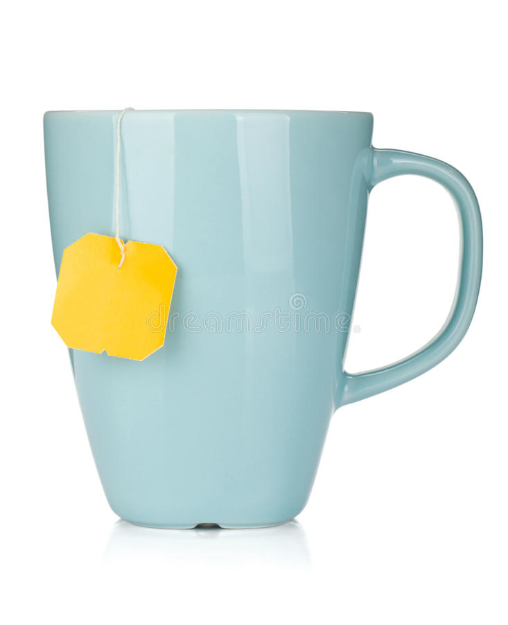 De kop van de thee met theezakje stock fotografie