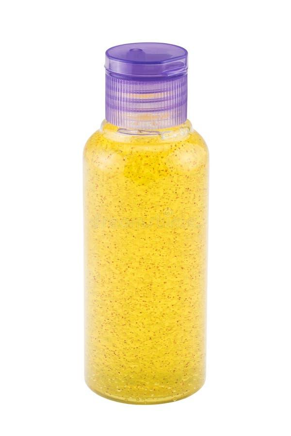 De kosmetische fles met douche schrobt royalty-vrije stock afbeelding