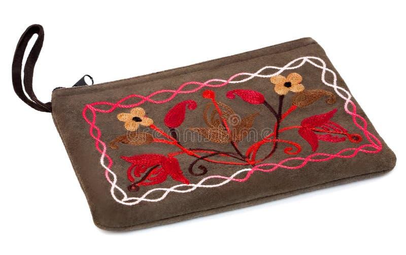De kosmetische zak met met de hand gemaakt borduurwerk stock afbeeldingen