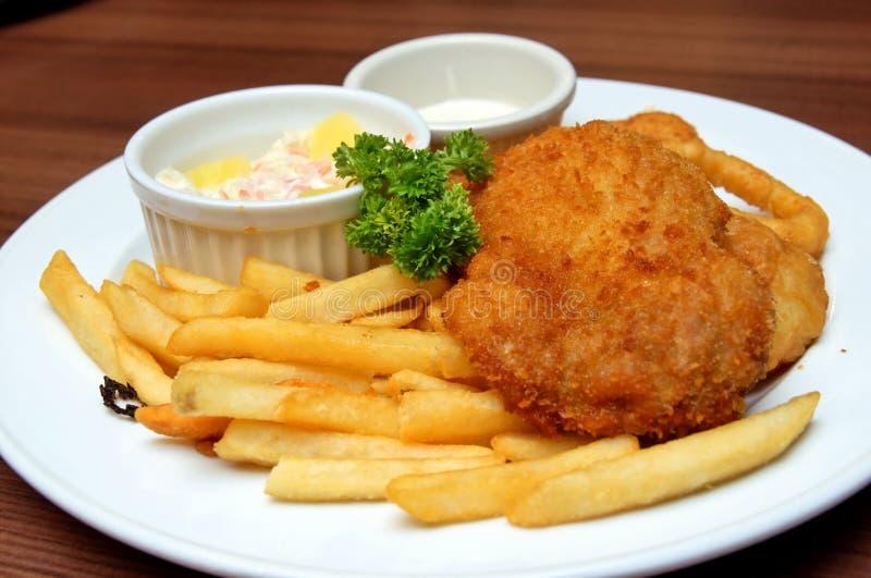 De koteletmaaltijd van de kip die in een restaurant wordt gediend royalty-vrije stock fotografie