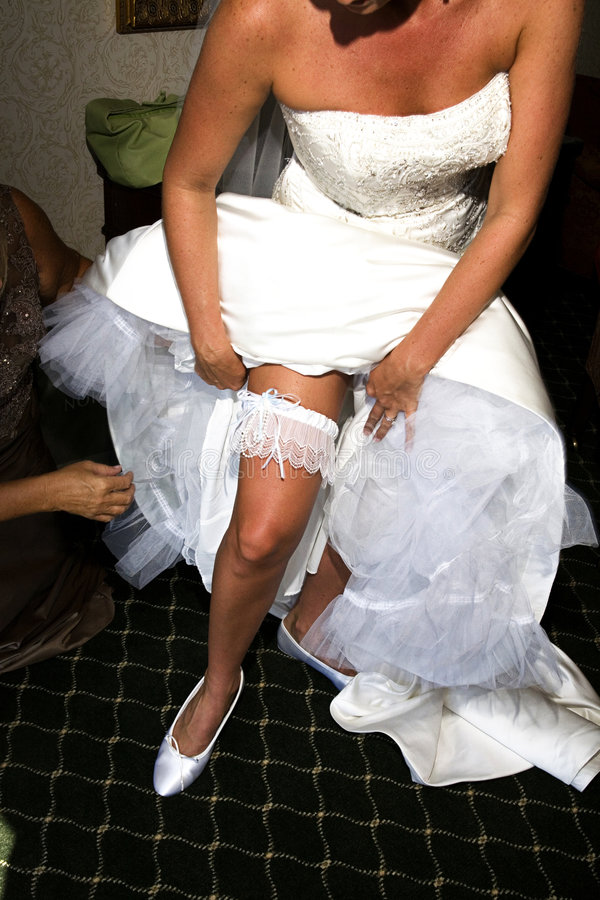 De kouseband van de bruid stock afbeeldingen