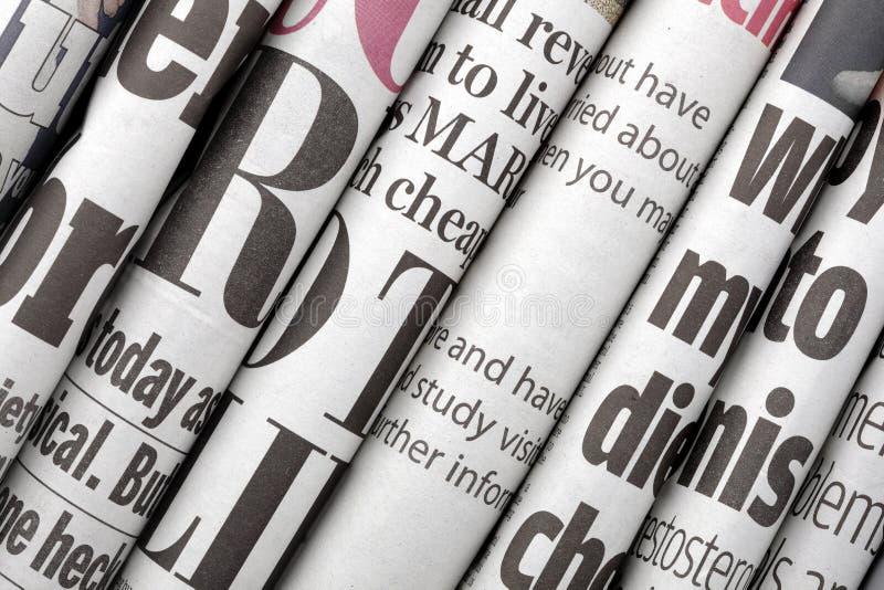 De krantekoppen van de krant stock fotografie