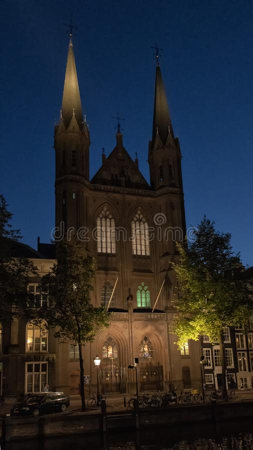 De Krijtberg Kerk at night, a Roman Catholic Church in Amsterdam loacted at the Singel stock photos