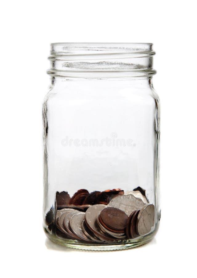 De kruik van het glas van muntstukken royalty-vrije stock afbeelding