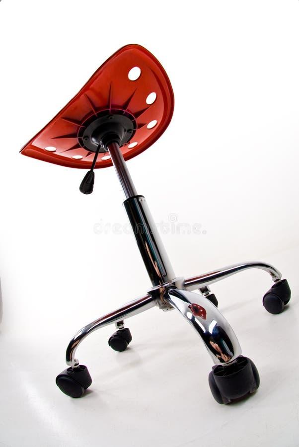 De kruk van het bureau op wielen stock afbeelding