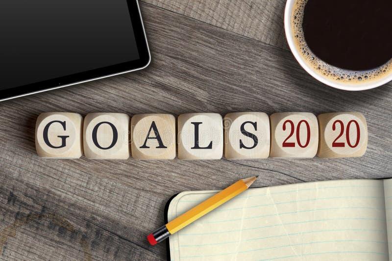 De kubussen en dobbelen met doelstellingen 2020 op een bureau royalty-vrije illustratie