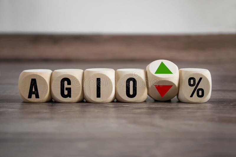 De kubussen en dobbelen met het financiële term AGIO stock foto's