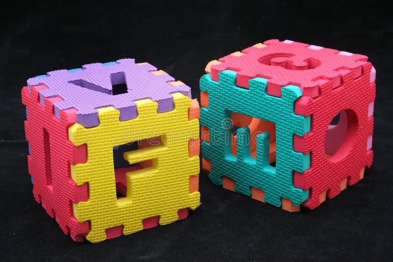 De kubussen van het raadsel met brieven royalty-vrije stock foto