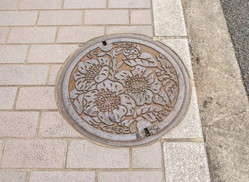 De kunst over het afvoerkanaal GLB op straat in de Prefectuur van Fukuoka stock afbeeldingen