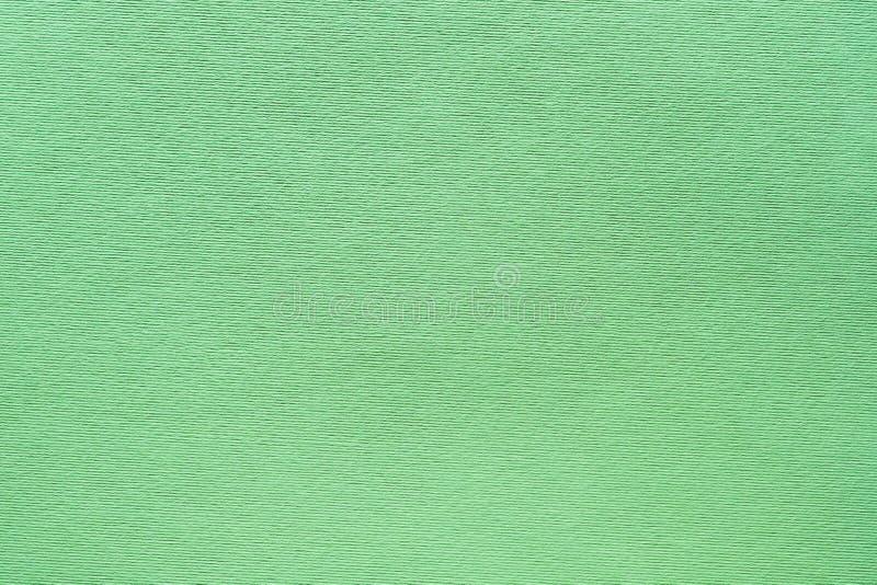 De kunst van de munt groen gevoeld textuur ribfluweel als achtergrond royalty-vrije stock fotografie