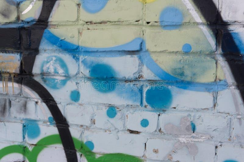 De kunst van de straatgraffiti op de het symboolmarkering van de muurslag stock fotografie