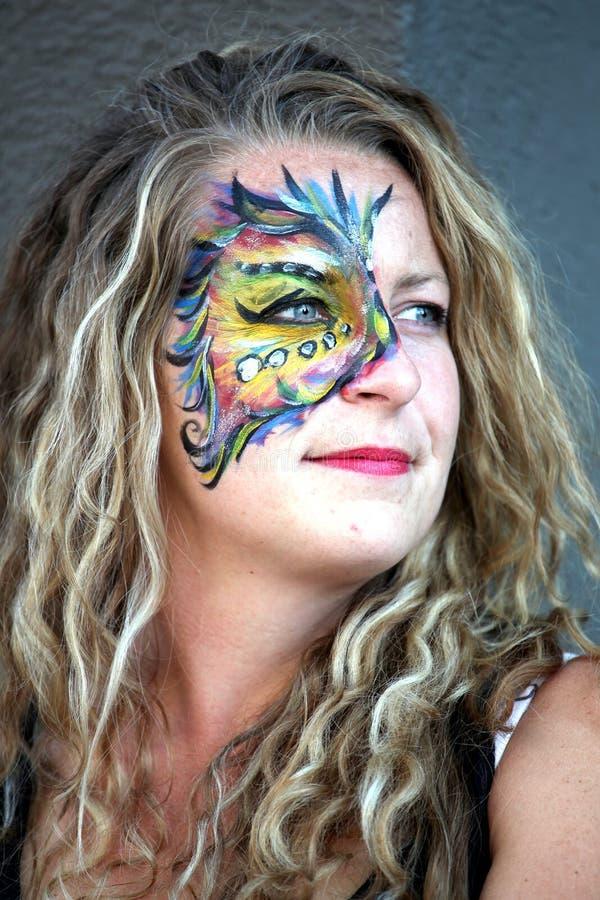 De kunstenaar van de gezichtsschilder stock fotografie