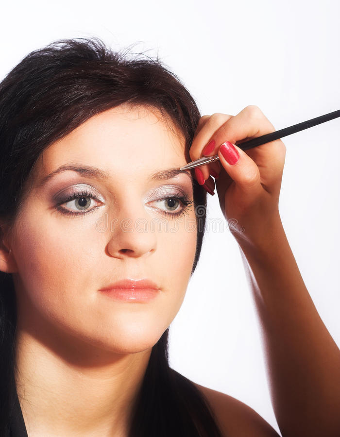 De kunstenaar van de make-up op het werk royalty-vrije stock fotografie