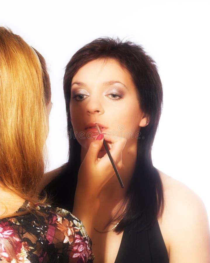 De kunstenaar van de make-up op het werk royalty-vrije stock foto